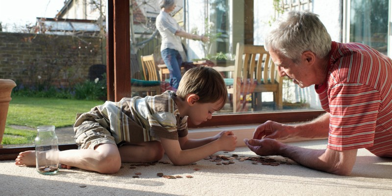 Grandpa talking about savings and superannuation to his grandson.